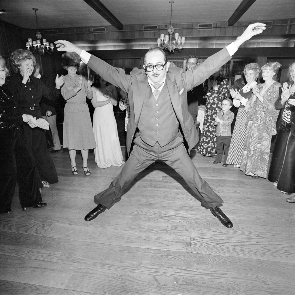 Meryl Meisler, Man in a 3 Piece Suit Dancing Within the Circle at a Wedding Rockville Centre, NY March 1976